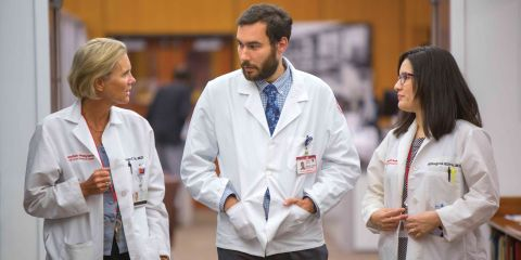 Weill Cornell Medicine physicians walking down hallway.
