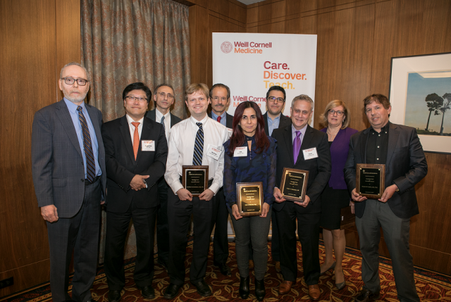 Dr. Augustine M.K. Choi, the Stephen and Suzanne Weiss Dean of Weill Cornell Medicine (second from left), and Larry Schlossman, managing director of BioPharma Alliances and Research Collaborations at Weill Cornell Medicine (first from left), join the winners of the Daedalus Fund for Innovation awards. From third from left: Dr. Shahin Rafii, Dr. Matthew Greenblatt, Dr. Lew Cantley, Dr. Julie Blander, Dr. Juan Cubillos-Ruiz, Dr. Peter Goldstein, Dr. Barbara Hempstead and Dr. Steven Lipkin.