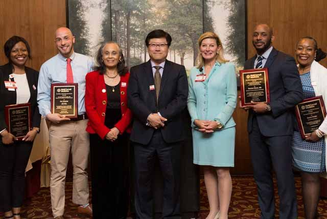Dean Choi standing with diversity awards recipients.
