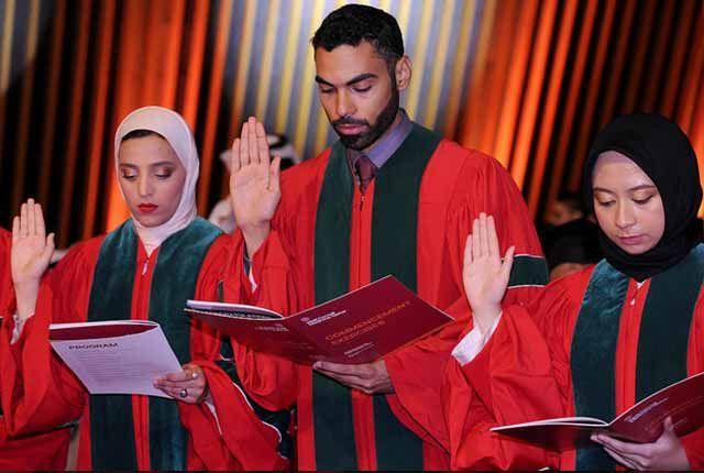 Graduates take an oath.
