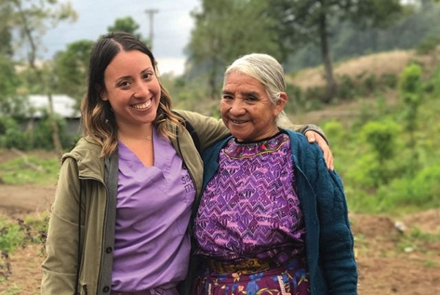 Dr. Sasha Hernández '18 (left) in Guatemala with one of the comadronas (birth attendants) that she worked with.